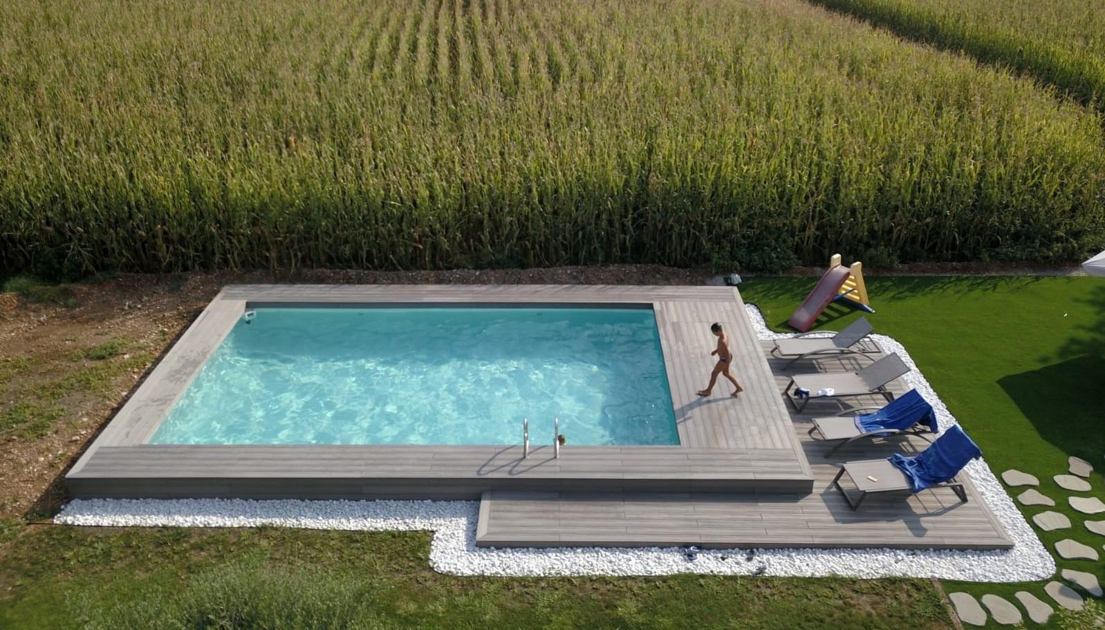 Piscine Interrate Prezzi Tutto Compreso piscina fuori terra semi-interrata. piscine