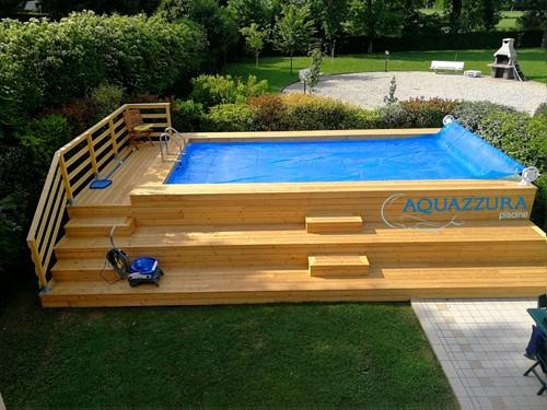 26. Piscina fuori terra rivestita in larice  Stupenda piscina con i suoi accessori , copertura estiva con rullo avvolgitore e robot pulizia